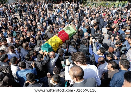 ISTANBUL, TURKEY - OCTOBER 12, 2015: Mourners carry the coffins of victims of Saturday's Ankara bombing attacks, during their funeral in Istanbul on October 12, 2015 in Istanbul, Turkey. - stock photo