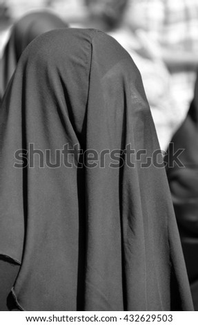 ISTANBUL TURKEY OCTOBER 08: Muslim veiled woman in the heart of downtown Istanbul on october 08 2013. The Turkish government banned women who wear headscarves from working in the public sector.