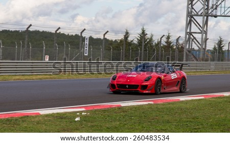 ISTANBUL, TURKEY - OCTOBER 25, 2014: P. Hannell drives Ferrari 599XX during XX Programmes of Ferrari Racing Days in Istanbul Park Racing Circuit