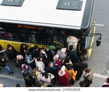 ISTANBUL, TURKEY - OCTOBER 08: Passengers waiting for bus at Yenibosna District on October 08,2014 in istanbul,Turkey.  - stock photo