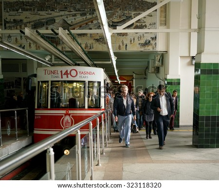 ISTANBUL, TURKEY - OCTOBER 02, 2015:People leaving the vagon at Beyoglu Tunel, a short historic underground railway line in Istanbul with two stations, connecting the quarters of Karakoy and Beyoglu. - stock photo