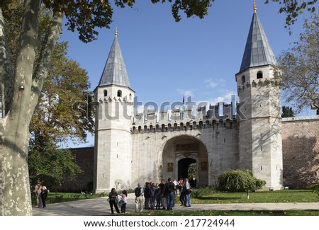 ISTANBUL, TURKEY - OCTOBER 21, 2010: Tourists gathering in front of the Gate of Salutation in Topkapi palace museum. Built in the late XV century, it's one of the main tourist attractions in Istanbul