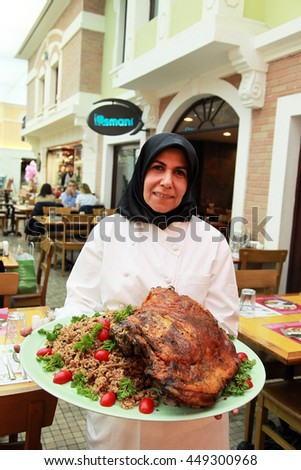 ISTANBUL, TURKEY - OCTOBER 9: Turkish woman chef showing traditional Ottoman food 'Lamb with Rice' (Turkish: Kuzu Kapama) on October 9, 2013 in Istanbul, Turkey. - stock photo