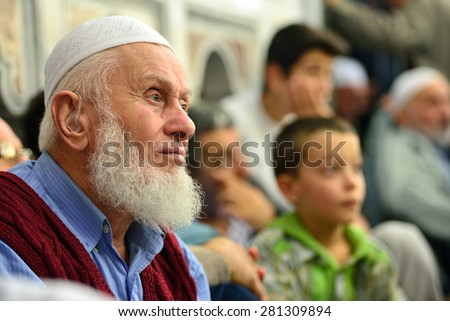 ISTANBUL, TURKEY - OCTOBER 6: Waiting for the old Muslim prayer at Fatih mosque October 6, 2013 in Istanbul. The mosque built by Fatih Sultan Mehmet was opened for worship in 1470. - stock photo