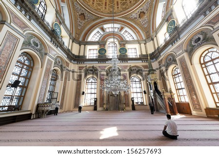 ISTANBUL, TURKEY - SEPTEMBER 26 : Dolmabahce Mosque on September 26, 2013 in Istanbul. Muslims praying at Dolmabahce Mosque in Istanbul.The mosque was constructed between 1853 and 1855