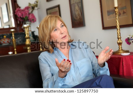 ISTANBUL, TURKEY - SEPTEMBER 25: Famous Turkish writer Ayse Kulin at book promotion press meeting on September 25, 2012 in Istanbul, Turkey. Ayse Kulin, Turkey's best selling biography books writer. - stock photo