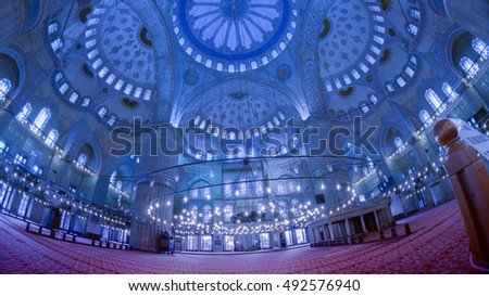 ISTANBUL, TURKEY-SEPTEMBER 25, 2016 :  Interior of Sultanahmet mosque with overall blue cast applied. The mosque is also called Blue Mosque because of extensive use of blue Iznik (Nicaae) tiles.