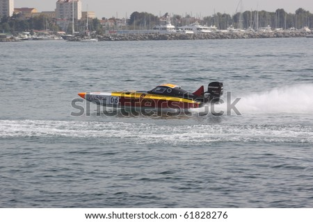 ISTANBUL, TURKEY - SEPTEMBER 19: Kerem TUNCER and Alpay Akdilek drive a Galatasaray Team Offshore 225 boat during Architon Offshore Championship, Moda stage on September 19, 2010 in Istanbul, Turkey