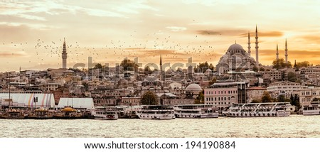 ISTANBUL, TURKEY - SEPTEMBER 28, 2013: Looking towards the Suleymaniye mosque from the Galata Bridge with passenger ships arriving to the port. - stock photo