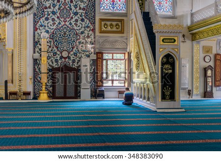 ISTANBUL, TURKEY - SEPTEMBER 05: Muslim prayer in the Tunahan Mosque on September 5, 2015 in Istanbul, Turkey. Tunahan mosque, is a big mosque was opened for worship in 2004. - stock photo