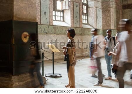 ISTANBUL, TURKEY - SEPTEMBER 23: People at the perspiring column (wishing, sweating, crying column) inside Hagia Sophia on September 23, 2014 in Istanbul, Turkey - stock photo