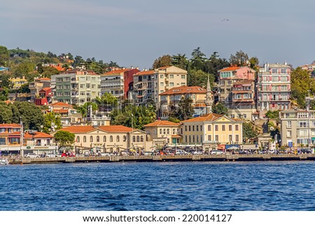 ISTANBUL, TURKEY - SEPTEMBER 29, 2013: View of the Arnavutkoy residental buildings sailing Bosporus.