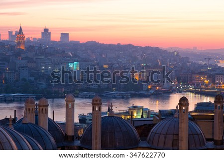 Istanbul, view of the Beyoglu and Galata Tower from the Suleymaniye Mosque at sunrise - stock photo