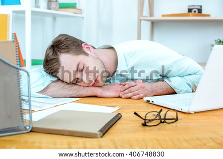 IT company. Young programmer with laptop. Nice office interier. Professional coder sleeping - stock photo