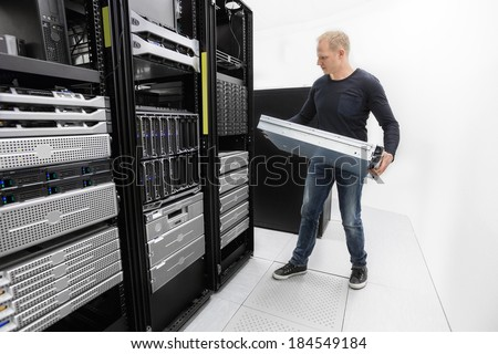It consultant install rack server in datacenter - stock photo