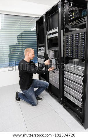 It consultant replace blade server in datacenter - stock photo