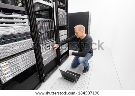 It consultant work with backup in datacenter - stock photo