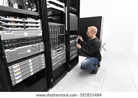 It consultant working with SAN in datacenter - stock photo