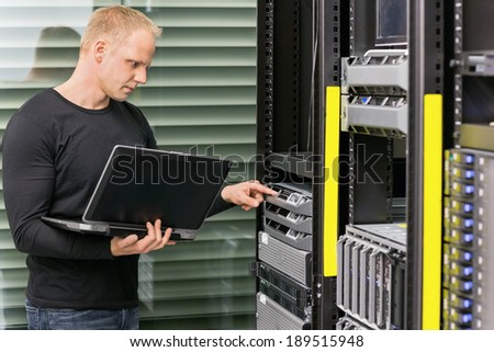 It consultant working with servers - stock photo