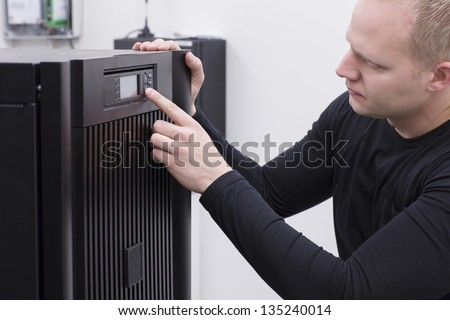 IT Engineer/ Consultant operate a large UPS in a data center. - stock photo