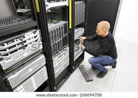 It engineer replace harddrive in datacenter - stock photo