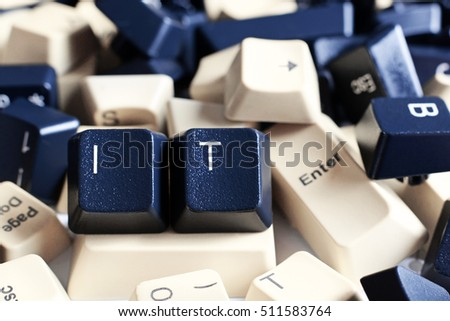 IT HELP,  Close-up on Pile of Black and White Computer Keyboard Keys. Two visible Keys have letters IT.
