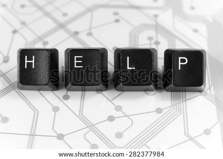 IT HELP, Four Black Keyboard keys on White Circuit Board Background - stock photo