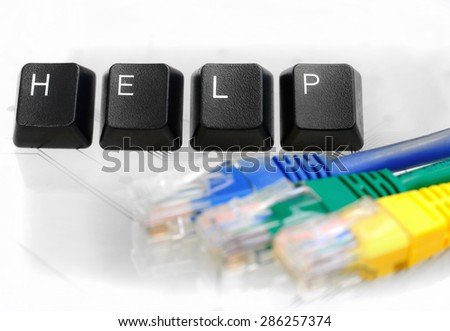 IT HELP - Four Black Keyboard Keys reading word HELP with Blue, Yellow and Green Network Cables on White Glass Background - stock photo