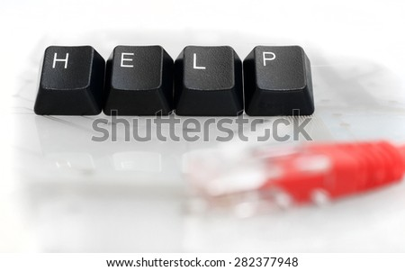 IT HELP - Four Black Keyboard Keys with Red Network Cable on White Glass Background - stock photo