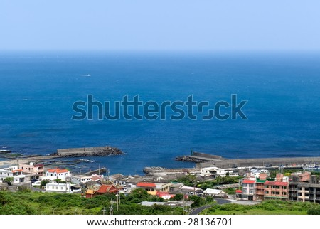It is a beautiful seascape of small town and blue sea water.