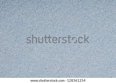 It is a close-up of blue knitted fabric. - stock photo