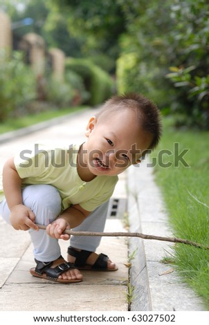 it is a cute chinese baby in the outdoor. - stock photo