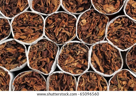 It is a lot of cigarets combined together, a background, a close up - stock photo