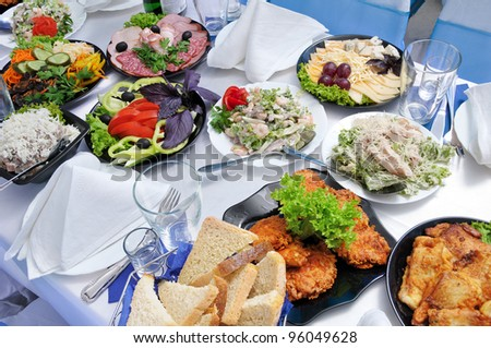 It is a lot of meal on a table - a table it is served for a banquet - stock photo