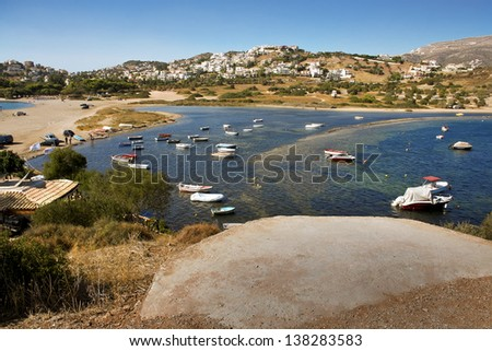 it is a lot of small wooden boats, boats, in the sea gulf. Beautiful sea landscape on the bank of the Gulf of Corinth, Greece, Europe, the Ionian Sea, the Balkans. The white city on the mountain