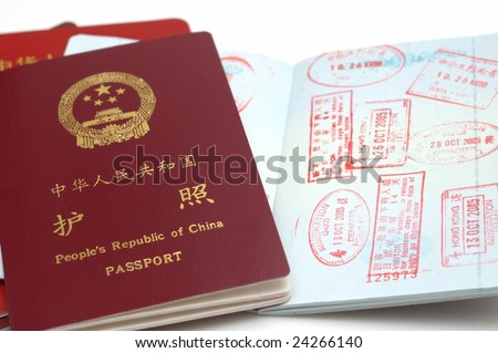 It is a new version passport of People's Republic of China. isolated. with a opening page, with Stamps. - stock photo