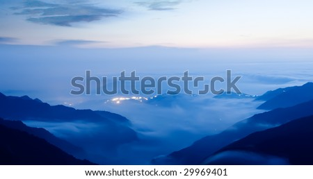 It is a peaceful small town with clouds in night. - stock photo
