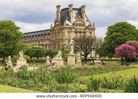 It is a Tuileries garden near the palace of the Louvre Museum at springtime May 12, 2013 in Paris, France.