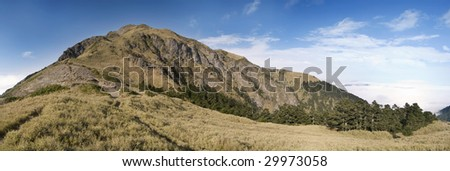 It is beautiful panorama mountain landscape with blue sky.
