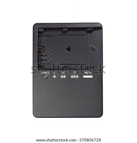 It is Black plastic battery charger isolated on white.