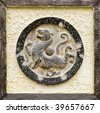 It is Chinese religious stone carving of tiger. - stock photo