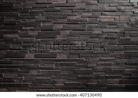 It is Dark black brick wall for pattern and background. - stock photo