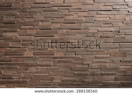 It is Dark  brown brick wall for pattern. - stock photo