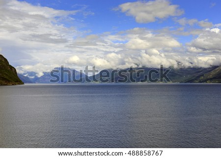 It is Hardangerfjord in south-western Norway, surrounded by rocky mountains, is by third longest in the world and the second in the country.