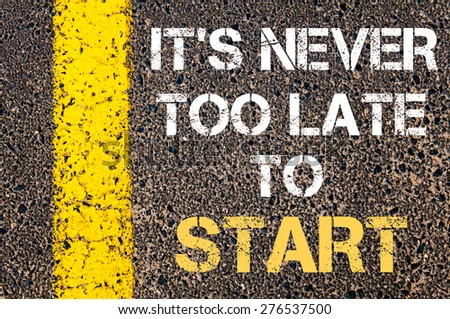 It is never too late to start motivational quote. Yellow paint line on the road against asphalt background. Concept image - stock photo