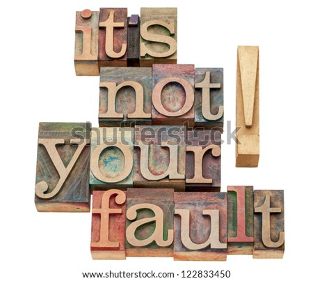 it is not your fault - isolated words in vintage letterpress wood type printing blocks - stock photo