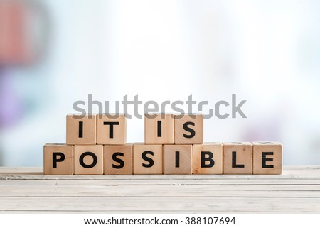 It is possible sign made of wooden cubes on a table