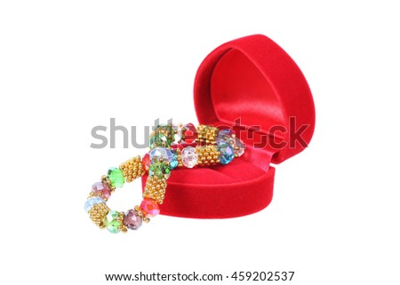 it is red heart shaped jewelry box with jewelry isolated on white.
