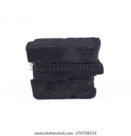 It is Stack of charcoal isolated on white. - stock photo