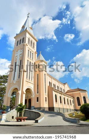 It is Vietnam Central Highlands most interesting and well-known Christian Church. The cathedral is locally known as the Cock Church due to the namesake weathercock on the cross on the spire. - stock photo